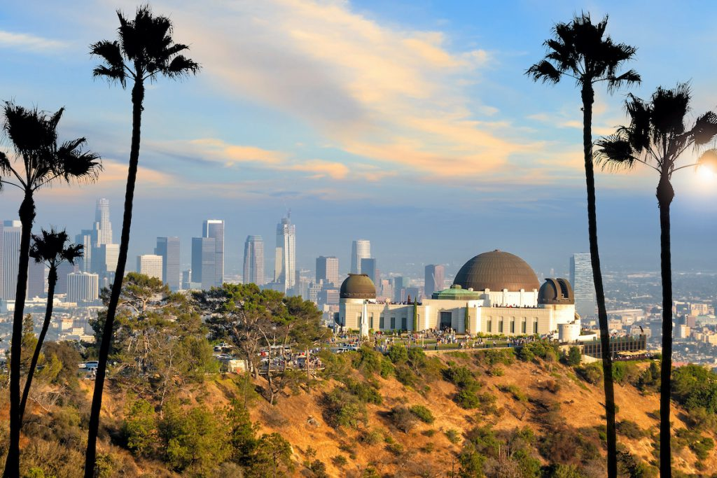 The Griffith Observatory and Los Angeles city skyline at sunset CA
